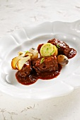 Chamois goulash with leek roulade and mushrooms