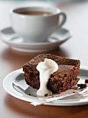 A brownie with cream