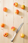 Fresh apricots on a wooden surface