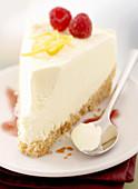 Frozen cheesecake with raspberries and lemon zest