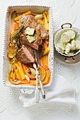 Rump steak with herb butter on a bed of braised carrots