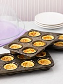 Mini butter tarts in a baking tin