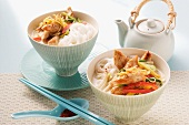Oriental coconut soup with rice noodles, chicken and vegetables