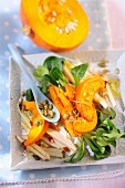 A salad with pumpkin, lambs lettuce and apple