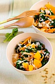 Green cabbage salad with carrots, oranges and sunflower seeds