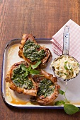 Pork chops with pesto and tagliatelle