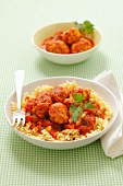 Fusilli pasta with chicken dumplings and tomato sauce