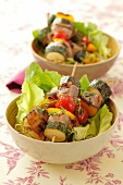 Pork and vegetable kebabs on lettuce