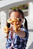 A little girl with mini sweet bread rings