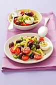 A bean salad with cherry tomatoes, olives and eggs