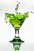 Yellow Cherry Splashing into a Green Apple Martini