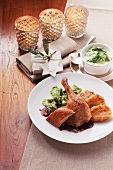 Roast duck with onion sauce, creamy savoy cabbage and napkin dumplings