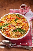 A pasta bake with sausages, peas and sweetcorn