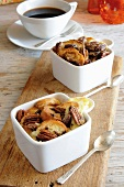 Bread and butter pudding with chocolate and pecan nuts