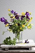 Bouquet of Japanese kerria, sweet peas & scented pelargoniums