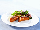 Grilled sausage with a side salad