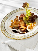 Fried goose liver with a mixed leaf salad