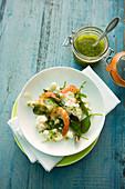 Cauliflower salad with prawns and a jar of pesto