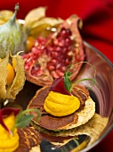 Canapes and exotic fruit on a cake stand