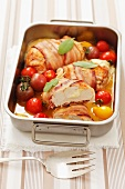 Chicken breast wrapped in bacon filled with mozzarella with cherry tomatoes