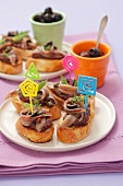 Crostini with tapenade and sardines