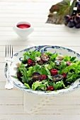 Mixed leaf salad with grapes and raspberries