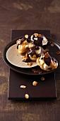 Profiteroles with chocolate glaze and slivered almonds