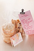 Coconut cookies with cranberry stems in cellophane bags for gift giving