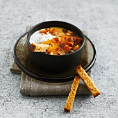 Coddled egg with carrots and spiced bread