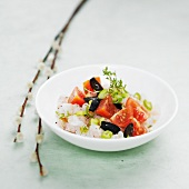 Fish tartare with tomatoes, olives and thyme