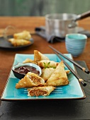 Fried pastry pockets stuffed with ground beef and dip