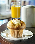 Vanilla muffin, coffee and orange juice