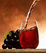 Pouring grape juice into a glass