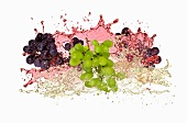 Red and green grapes with wine splash