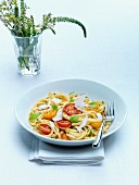 Tagliatelle with red and yellow cherry tomatoes, basil and shaved parmesan