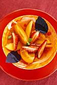 Fruit salad with basil sauce