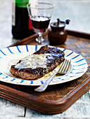 Steak topped with grilled Spanish blue cheese