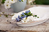 A place setting decorated with forget-me-not and garden jasmine