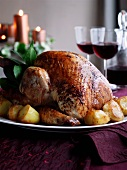 Roast turkey with potatoes for Christmas dinner