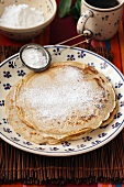 Wholemeal pancake with icing sugar