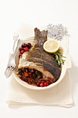 Stuffed carp with buckwheat, mushrooms and vegetables
