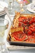 Tomato, ham and cheese tart, sliced