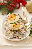 Herring with egg, gherkins and chanterelle mushrooms