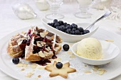 Waffles with blueberries and vanilla ice cream