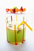 A long drink with mint and fruits