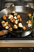 Fried brown mushrooms in a pan