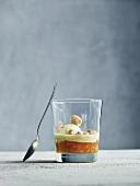 Orange dessert with vanilla ice cream in a glass