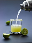 A lime drink being poured