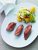 Pork fillet with a potato and apple salad