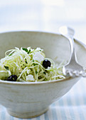White cabbage salad with black olives